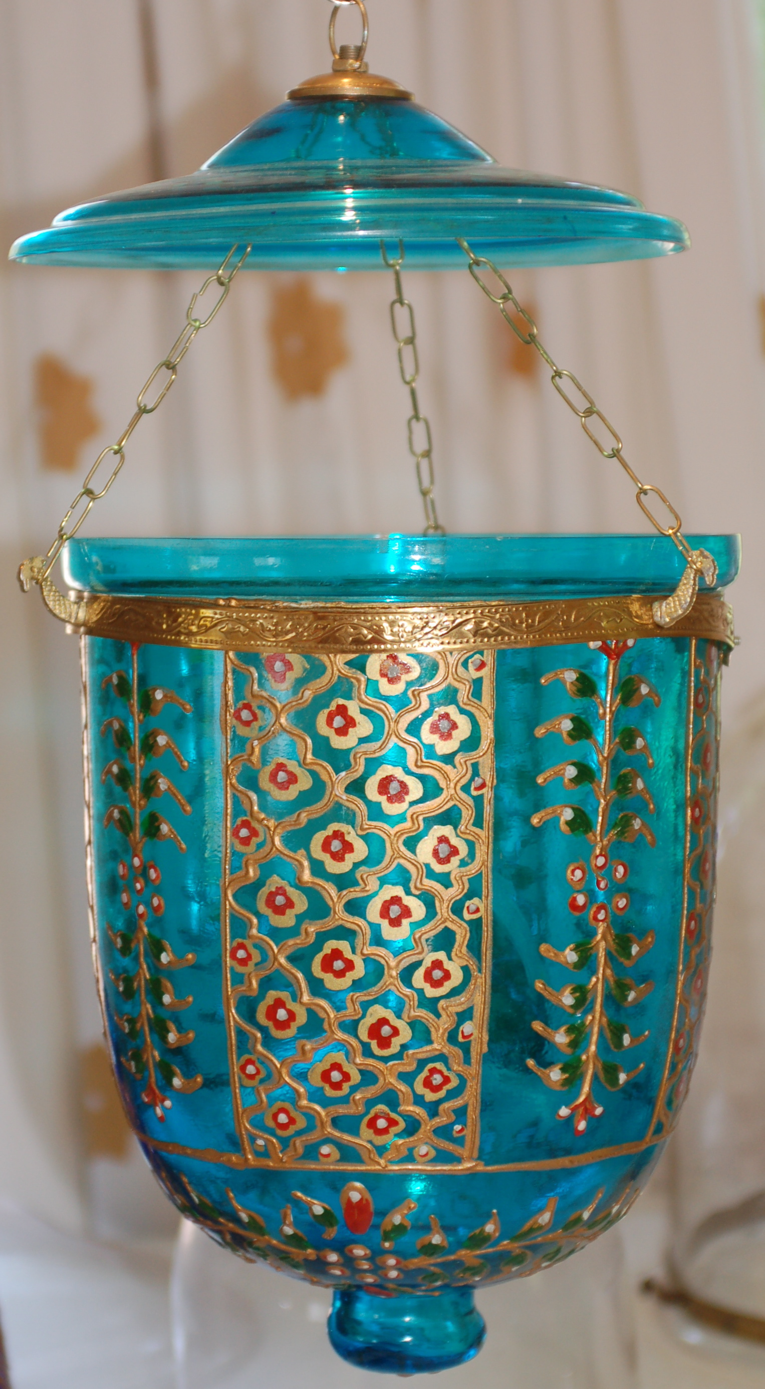 "Turquoise embossed hanging lantern, not fitted for electricity.  Approximately 18"" high; 10"" diameter"