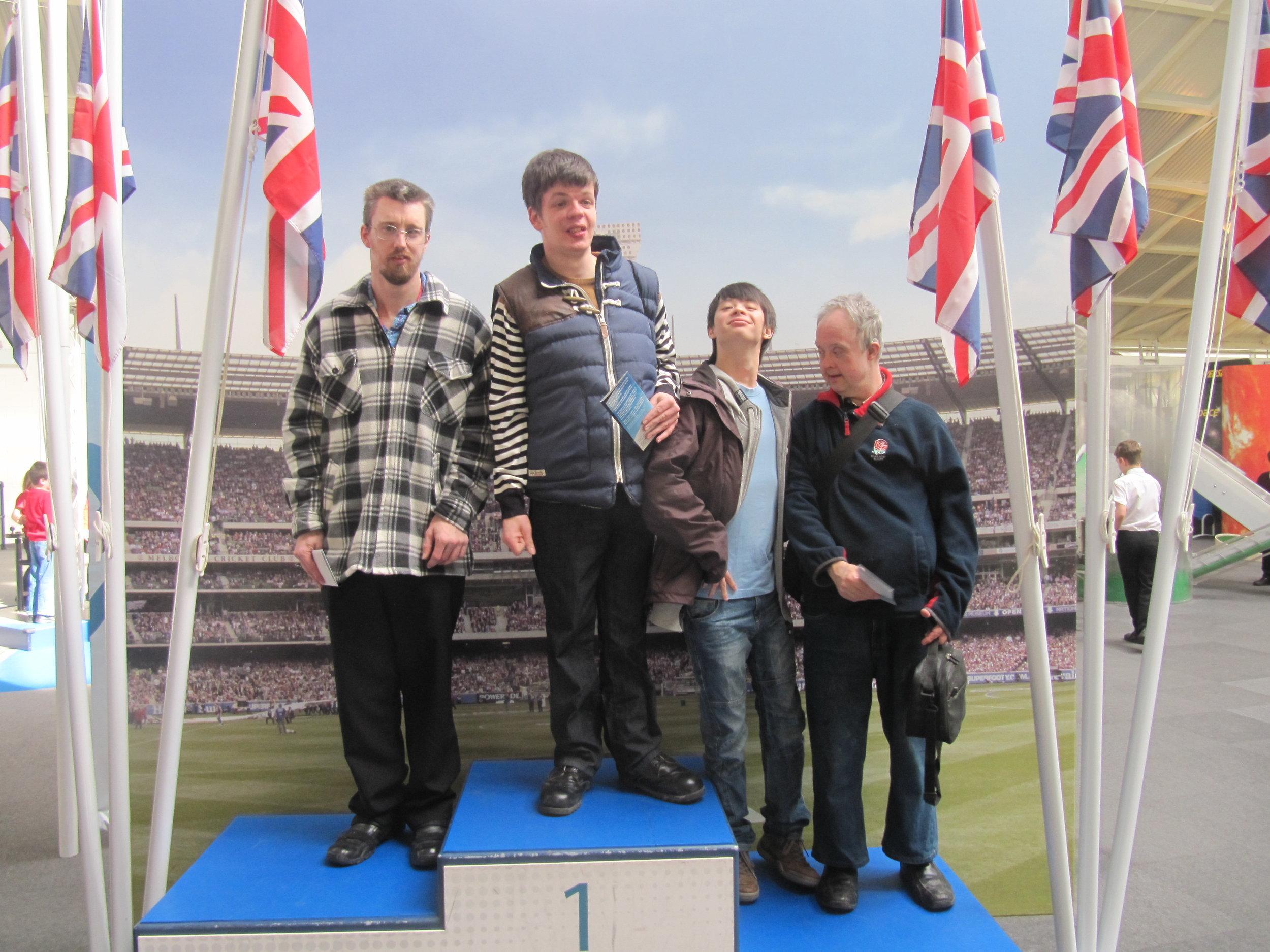 Alan, Lewis, Paul, Nick on podium.JPG