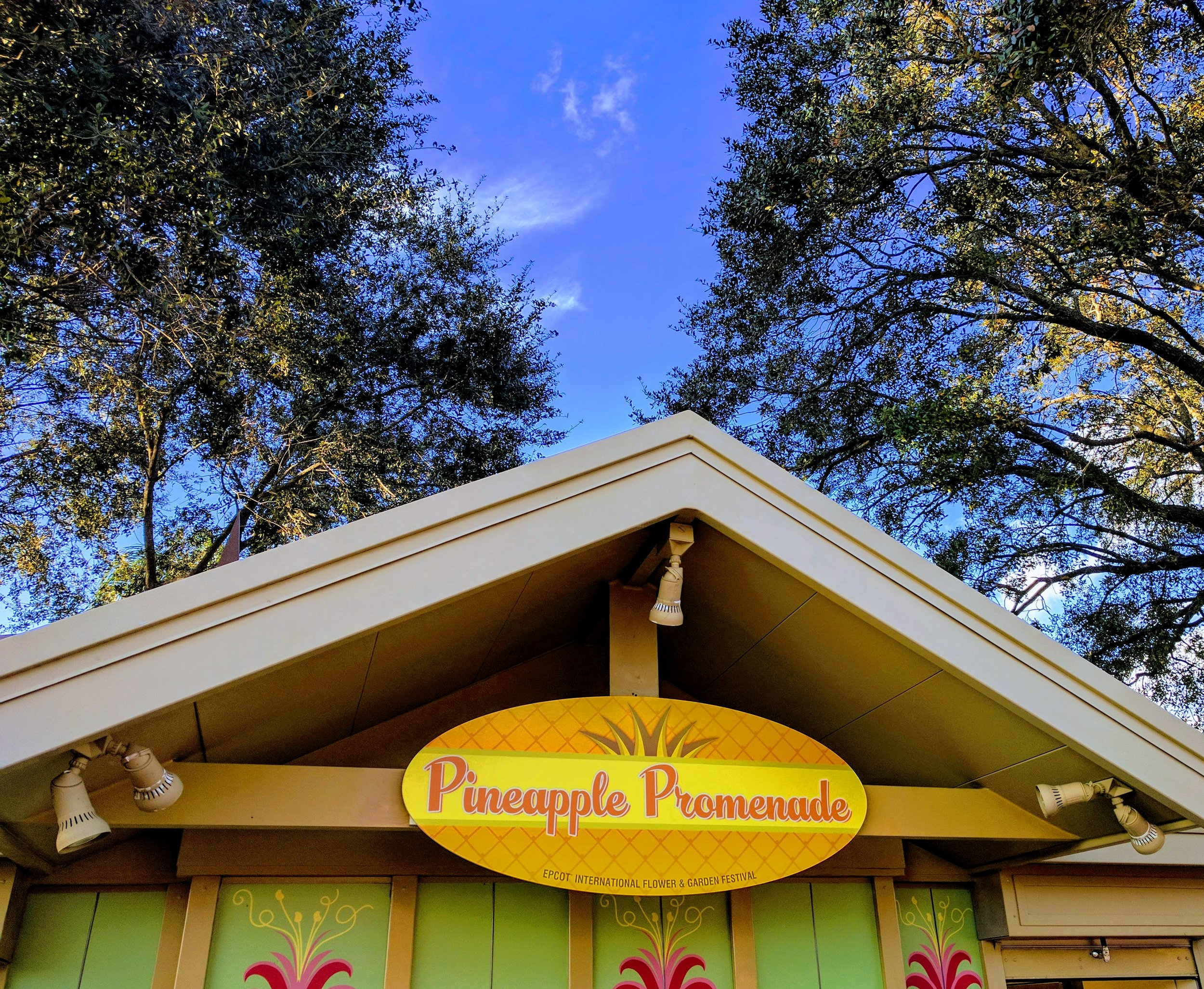 The Pineapple Promenade is the first booth to the right at the main entrance of the World Showcase. It is hard to miss with its bright pineapple designs.