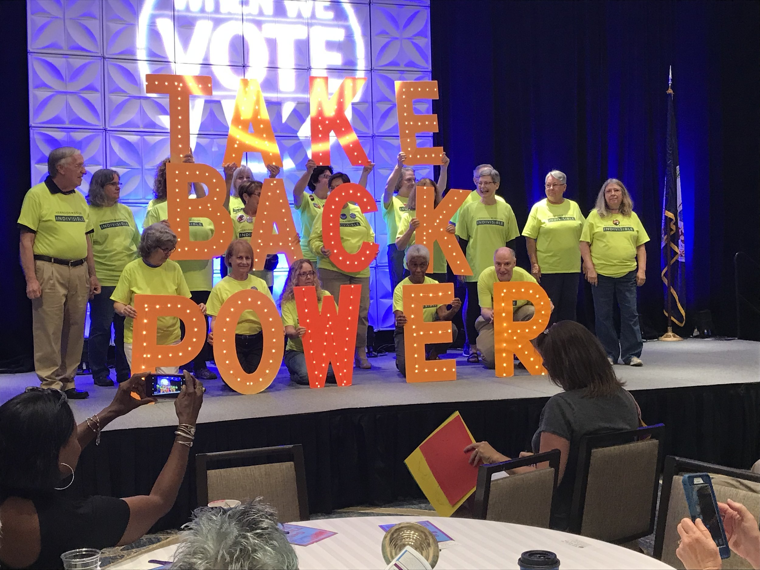 "Herndon-Reston Indivisible with their ""Take Back Power"" lights at the Virginia Women's Summit. (June 2019)"