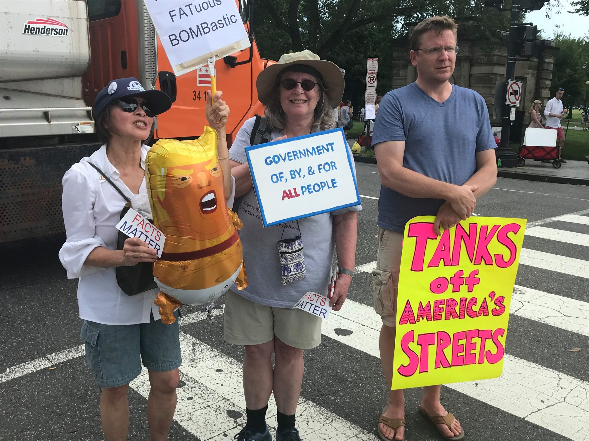 NOPEsters and friend protesting Trump's presence at July 4 festivities.