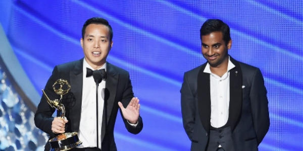 "Actor/writer Aziz Ansari (R) and writer Alan Yang (L) accept the award for Outstanding Writing for a Comedy Series for the  Master of None  episode ""Parents"" during the 68th Annual Primetime Emmy Awards on September 18, 2016."