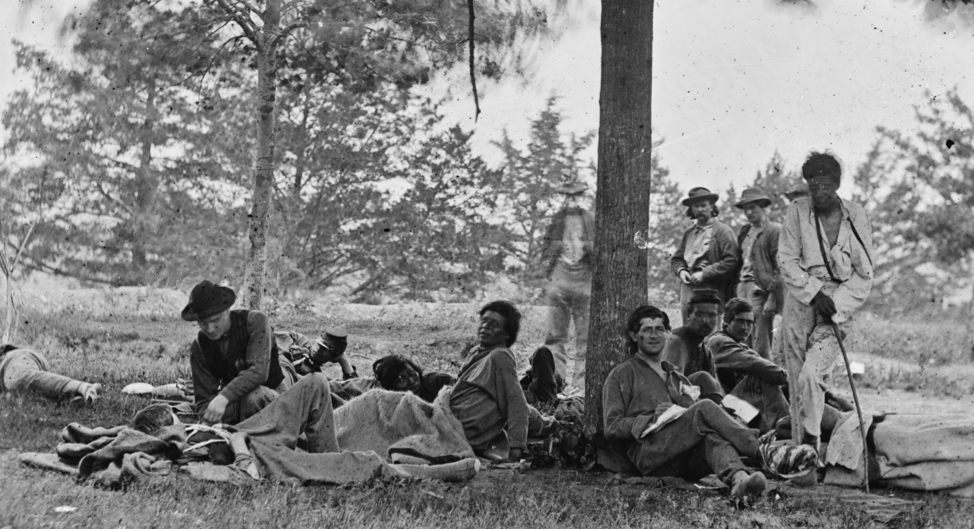 Injured soldiers at a hospital near Fredericksburg, VA. The man standing on the far right may be Thomas Kechittigo from Saganing, who was wounded in his left arm from a shell fragment at Spotsylvania on May 12, 1864. Source: LC-DIG-cwpb-01550, Library of Congress, Washington D.C.