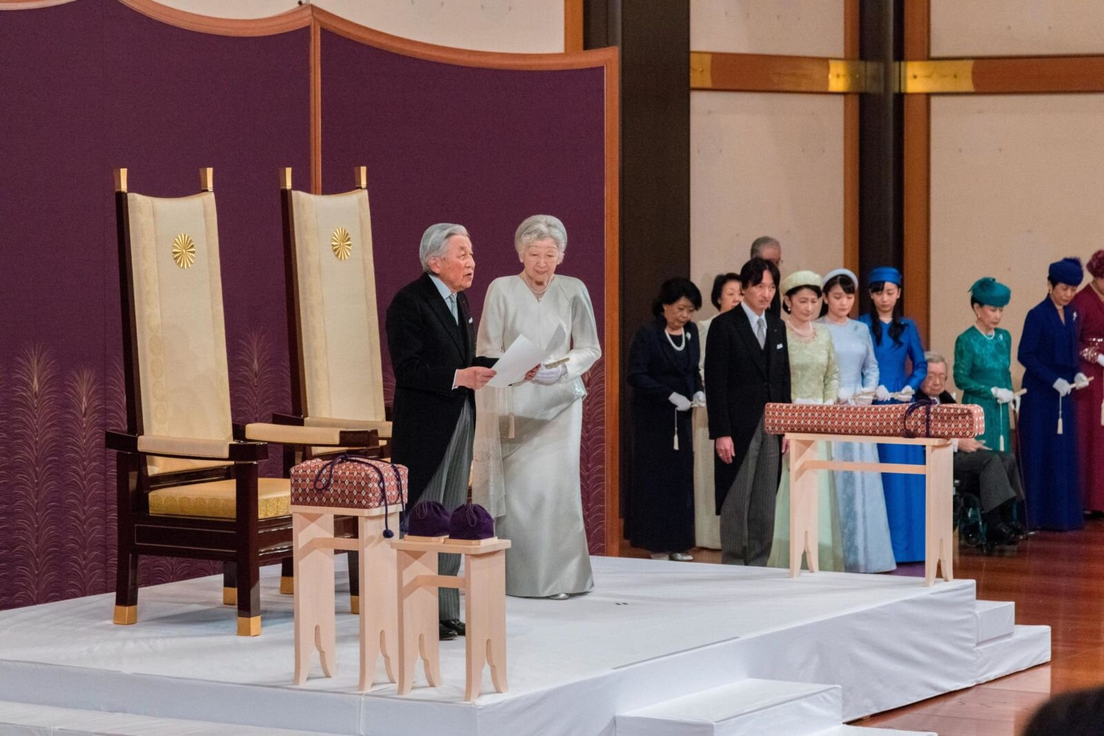 Akihito, joined by Empress Michiko and members of the royal family, speaks during his abdication ceremony on April 30.