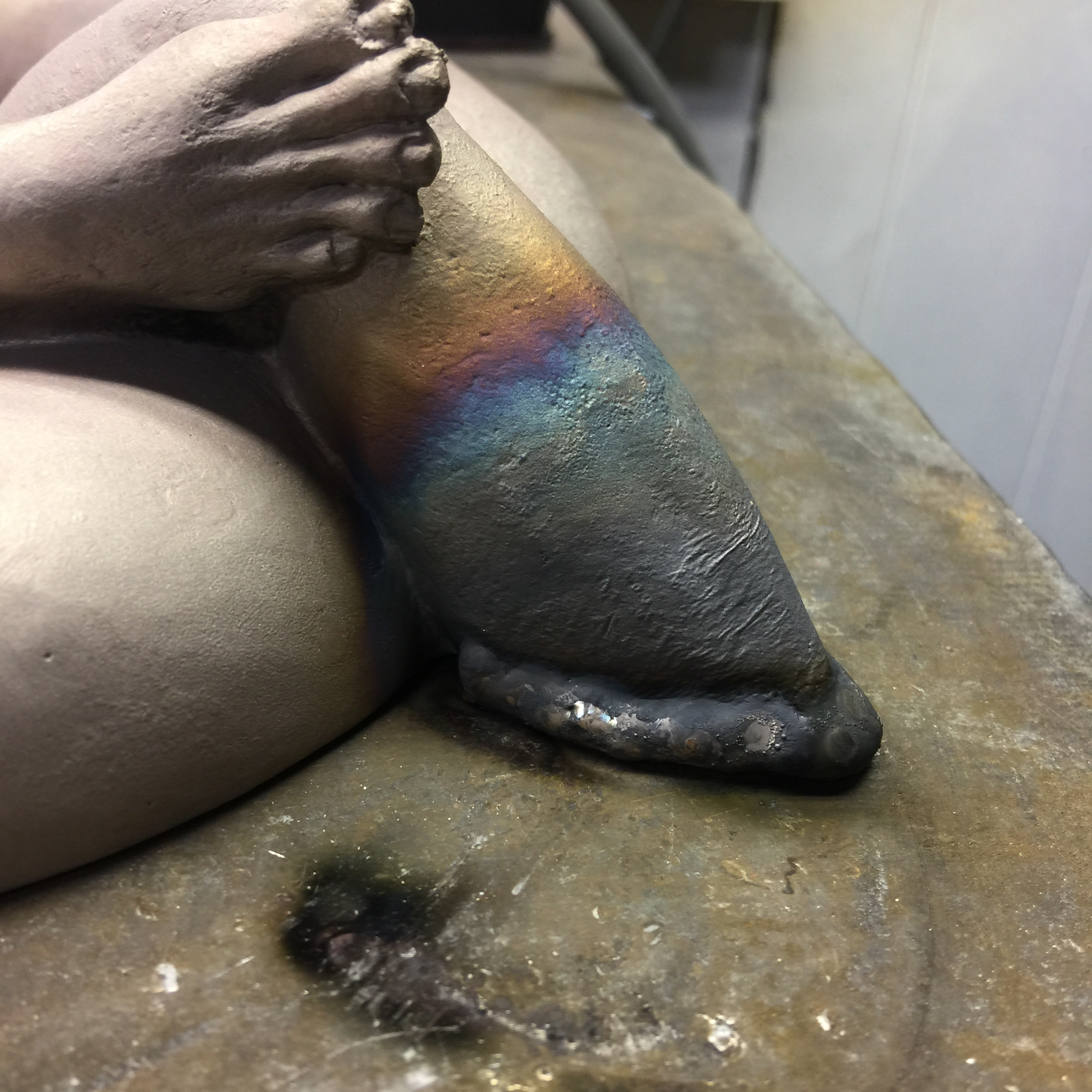 The press along with some hammering got the perimeter of the tube down, but the arm & leg shrunk in the fire, so I'm adding bronze by TIG welding.