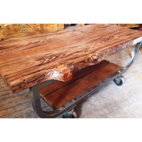 "$ Inquire   Live Edge rolling coffee table. Made from a chunk of wood the boys from  @m3cdemolitionto  salvaged with a vintage metal Canadian Post office cart as the base. Roughly 44"" x 20.25""."