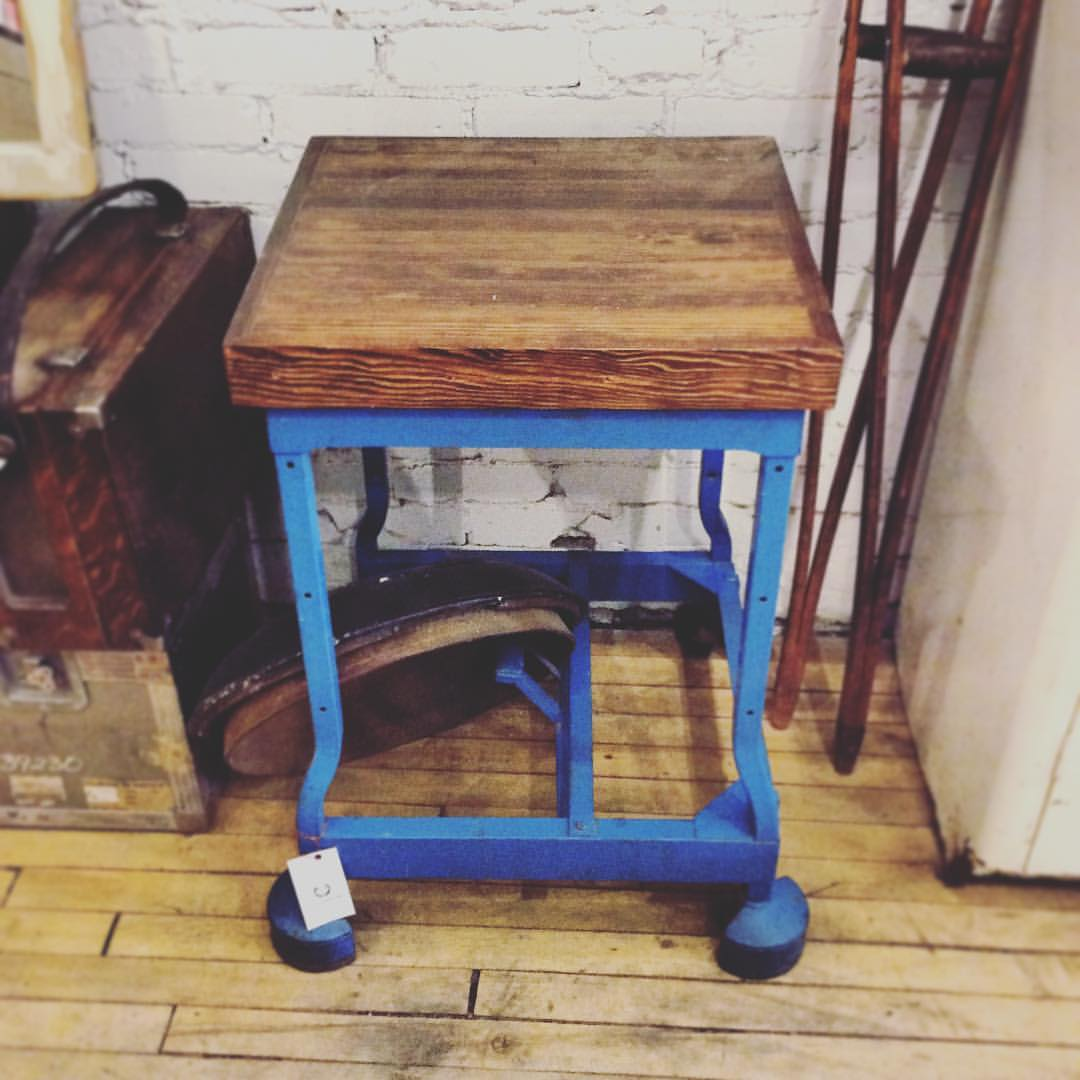 $ 225   A small, refurbished, industrial side table with wheels   and reclaimed wood top.
