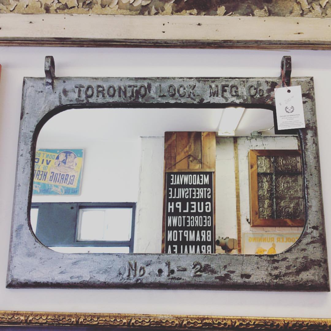 SOLD   A large industrial mirror made from a Toronto lock MFG co panel.
