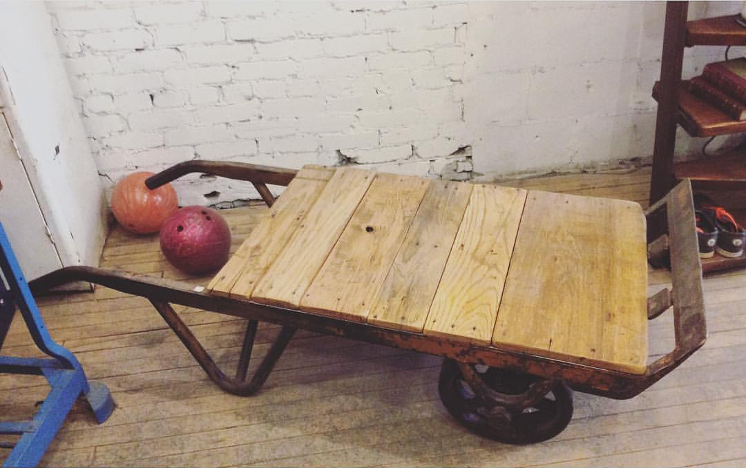 $ Inquire   An antique cart turned into a coffee table! Wheels are working so it makes moving this table very easy. It can also be stood up and out of the way temporarily until needed.