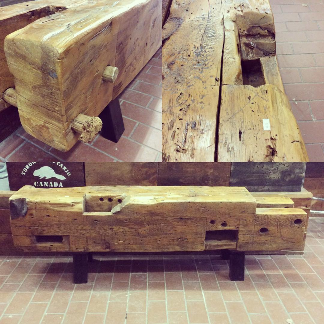 $ Inquire   Large beam bench salvaged from an old barn located in Ontario. It's one of many beams taken from the site and turned into this rustic piece! It has metal legs and a smooth finish.