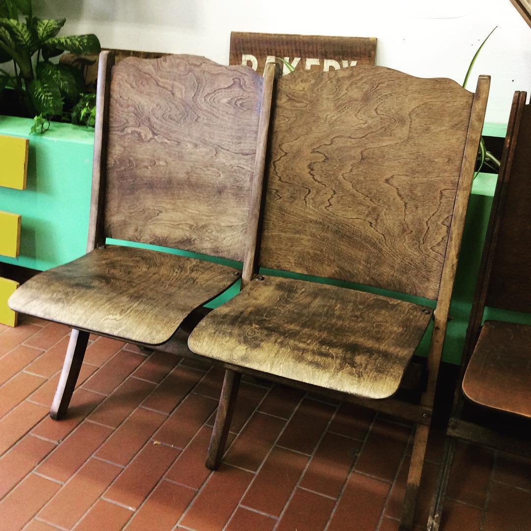 SOLD   Like the single church chairs but have a friend? Here's a two-seater version of the finished church chairs. Sanded down and stained to reveal the gorgeous wood grain hiding underneath.   We may also be able to do this with our three-seaters for those popular folks! Inquire if you're interested.