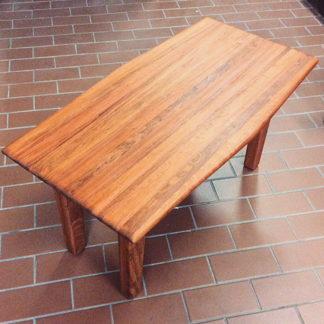 $500   African cherry wood Danish inspired coffee table with oil rubbed finish. Smooth / soft texture. 33 1/2'' x 17 1/2'' x 17 1/8''.