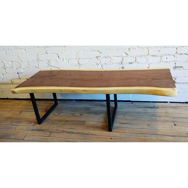 Live edge walnut coffee table with offset metal legs. You know you want to run your hands along those sleek lines. . . . #junctionstores #junctionto #madeinthejunction #custommade #customfurniture #salvage #architecturalsalvage #reducereuserecycle #bespoke #woodworking #design #decor #interiordesign #reclaimedwood #liveedgetable #walnut #woodmanns