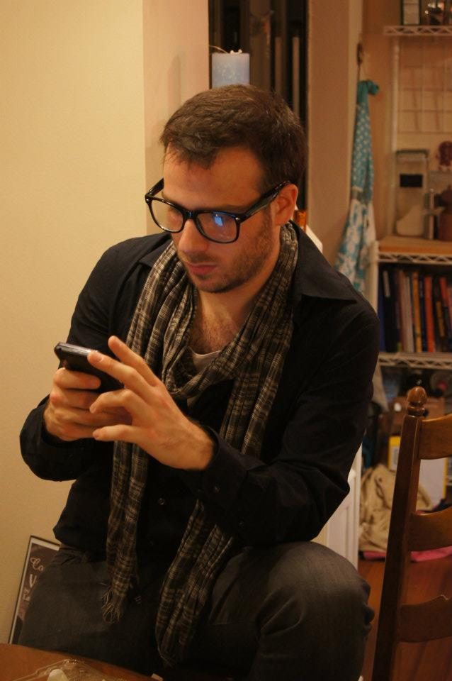 Jacob uses his important smartphone to look at pictures of kittens.