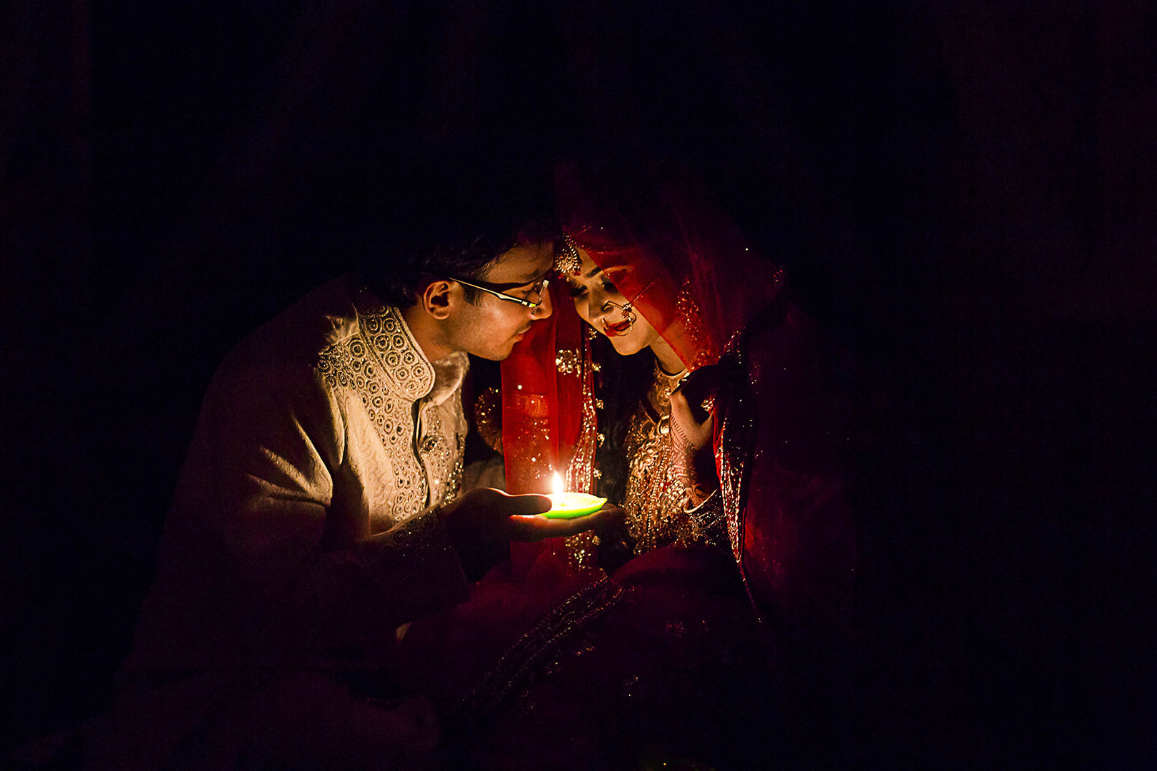 Photographer: Gobinda Paul   Country:   Bangladesh  Title: The candlelight reveals love