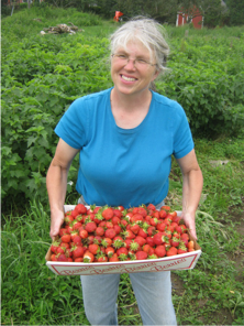 Nancy with a tray of strawberries