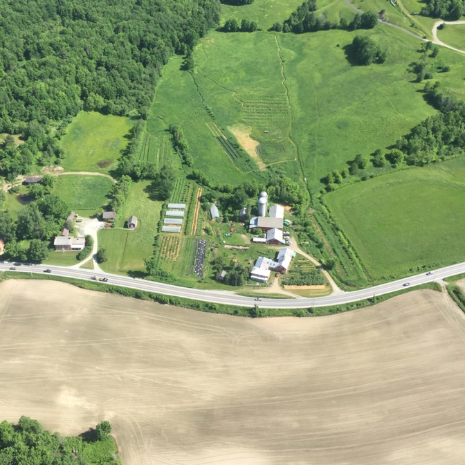 The Farm Between in the spring of 2017 -Across the street is a conventional cornfield before planting. Can you guess which system is more regenerative?