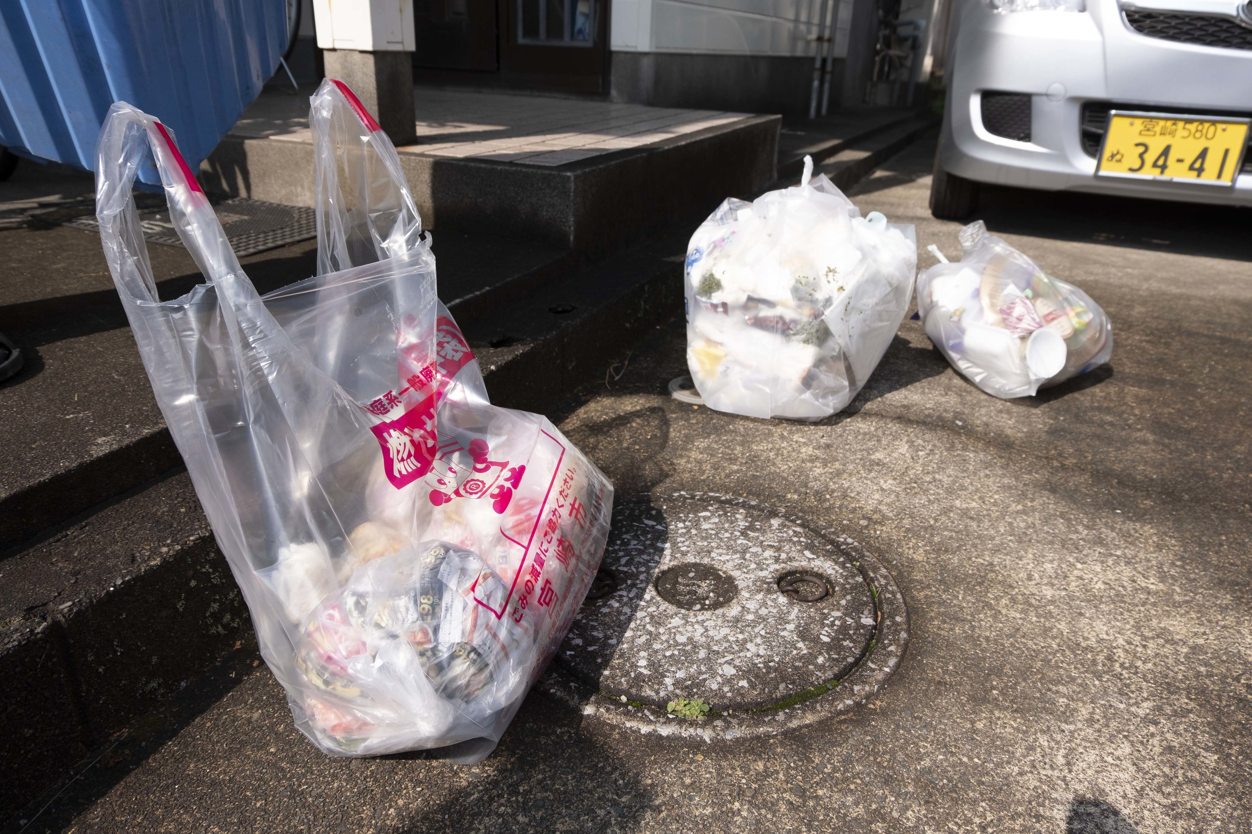 Sorting of household waste in Miyazaki, Kyushu, Japan (2017). Household waste is sorted in bags and then placed on a neighborhood corner multiple times a week.