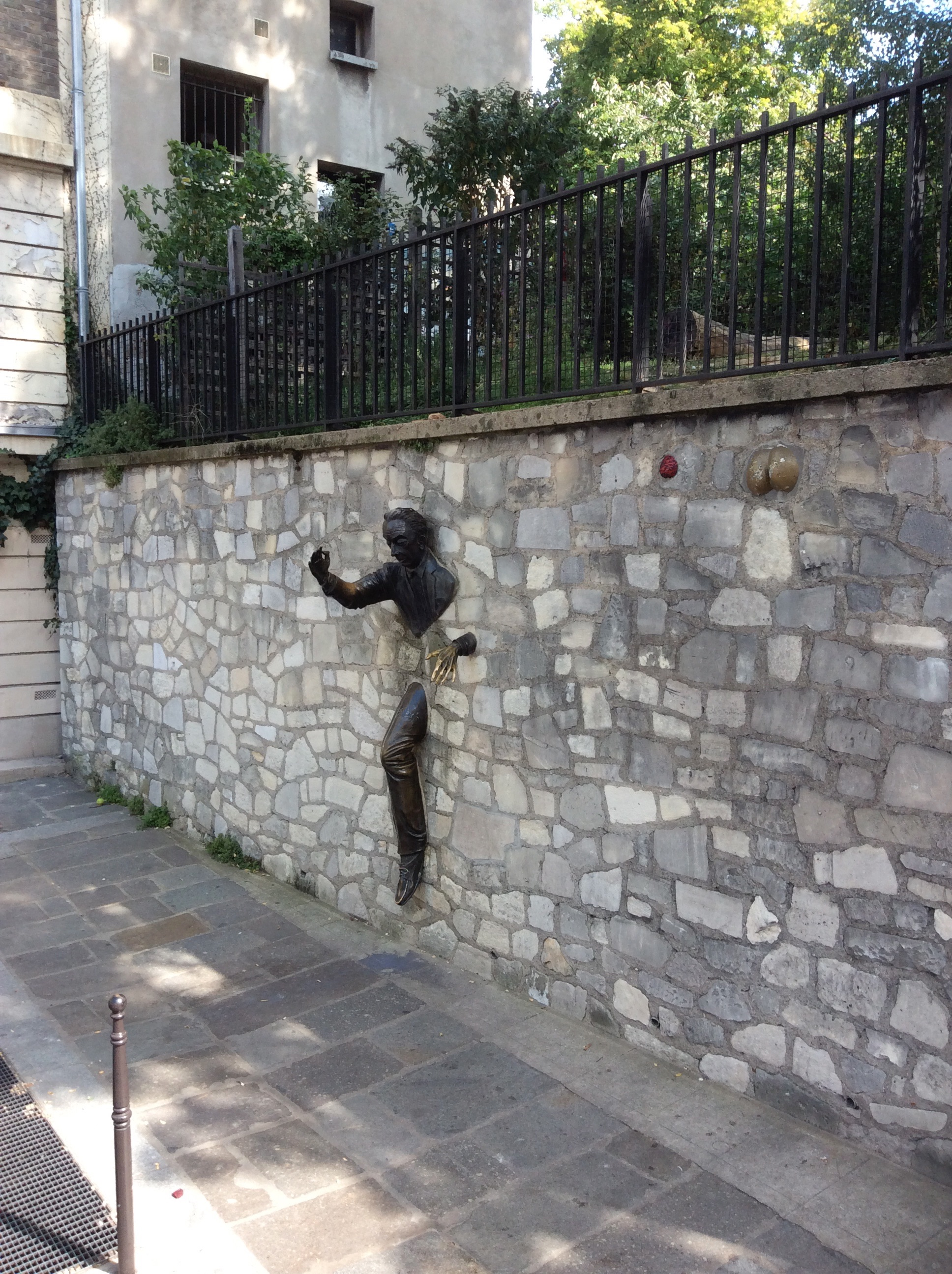 Walking through the Montmartre arrondissement in paris from the Sacre-Coeur to the Moulin rouge we came around a corner to see the man escaping from the wall.  At times we all feel like we are trying to break free.