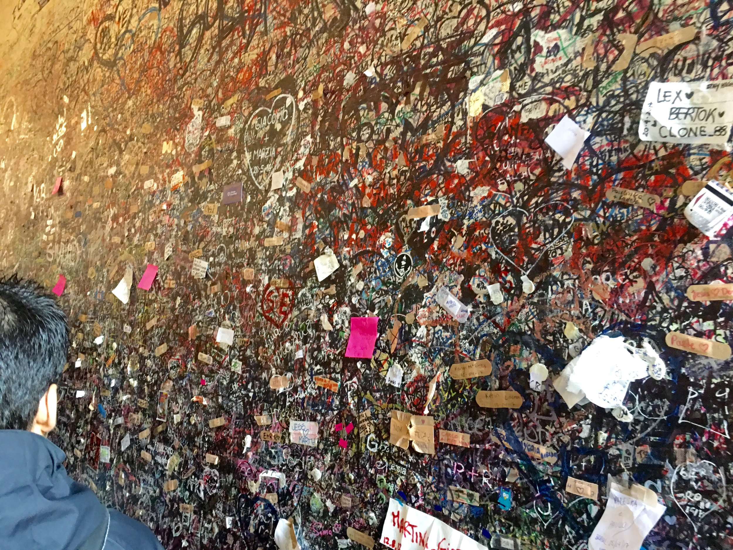 Lovers have written notes until the wall has turned black. Now the love notes require a post-it note or a band-aid.