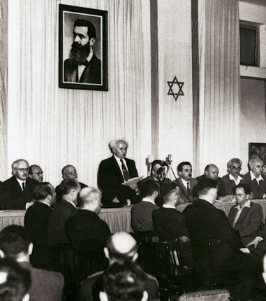 Minutes before the British Empire relinquished its hold on the area of Palestine David Ben-Gurion, the future prime Minister of Israel announced the formation of the state in the Tel Aviv Museum of Art on Rothschild Street. The date was May 14, 1948, (5 lyar of the Hebrew calendar) Tel Aviv, Israel. Photograph by  Rudi Weissenstein   https://upload.wikimedia.org/wikipedia/commons/b/b8/Declaration_of_State_of_Israel_1948_2.jpg