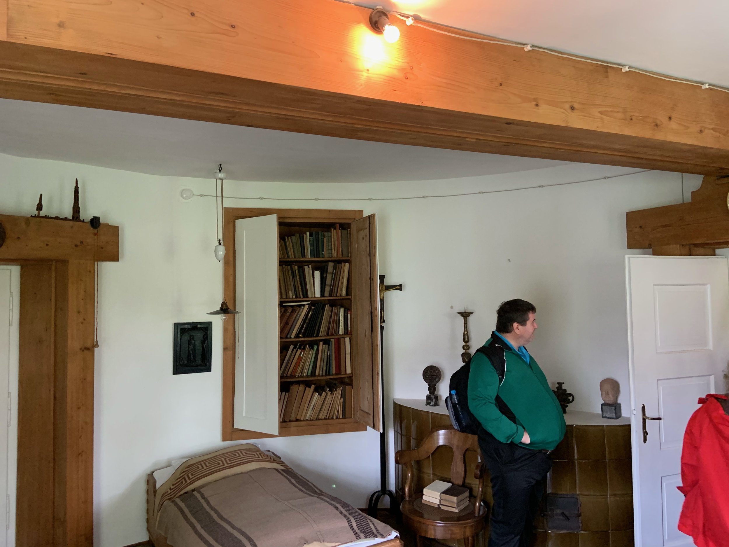Plecnik House. Here are two pictures from his bedroom. The room is perfectly round but is divided in two by a central beam (not a ceiling support beam), which separates the room into two sections. One section contains the sleeping area, the other a workbench.