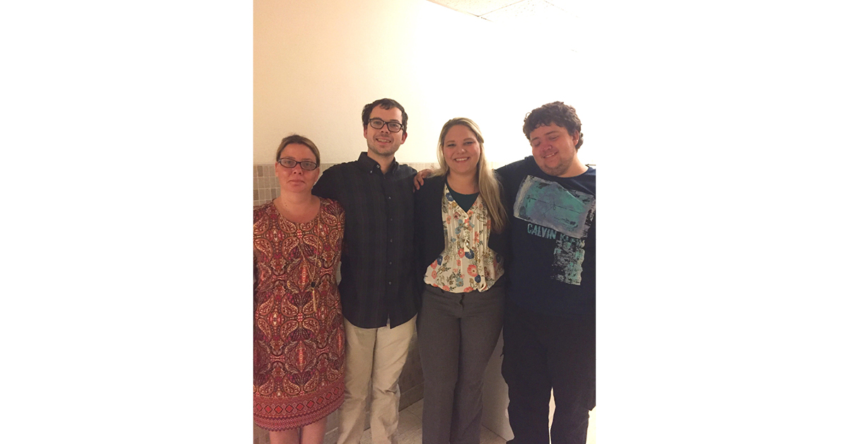 My mom, brothers, and me after I defended my master's thesis, June 26, 2017.