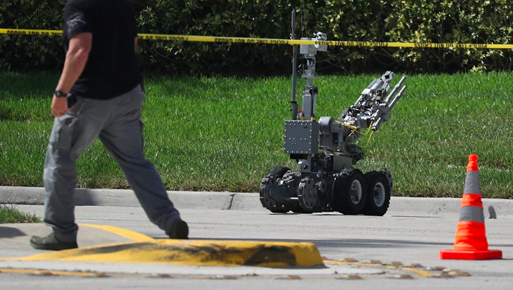 The Broward Sheriff's Office bomb squad deploys a robotic vehicle to investigate a suspicious package in the building where Rep. Debbie Wasserman Schultz (D-FL) has an offce on October 24, 2018 in Sunrise, Florida. - Via  Khou