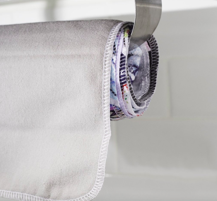 Invest in some good quality cloth, replace your paper towel dispenser with the cloth, use it, wash it, and use again!