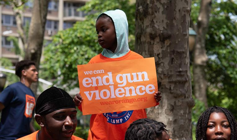 "Protestors at the ""Walk In Solidarity With Survivors"" to end gun violence in New York City. via  City & State New York"