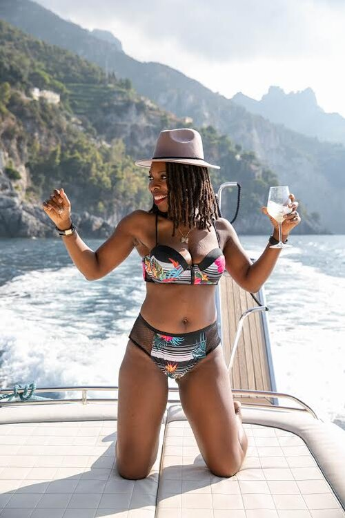 Chandra on a yacht enjoying and celebrating life in Positano