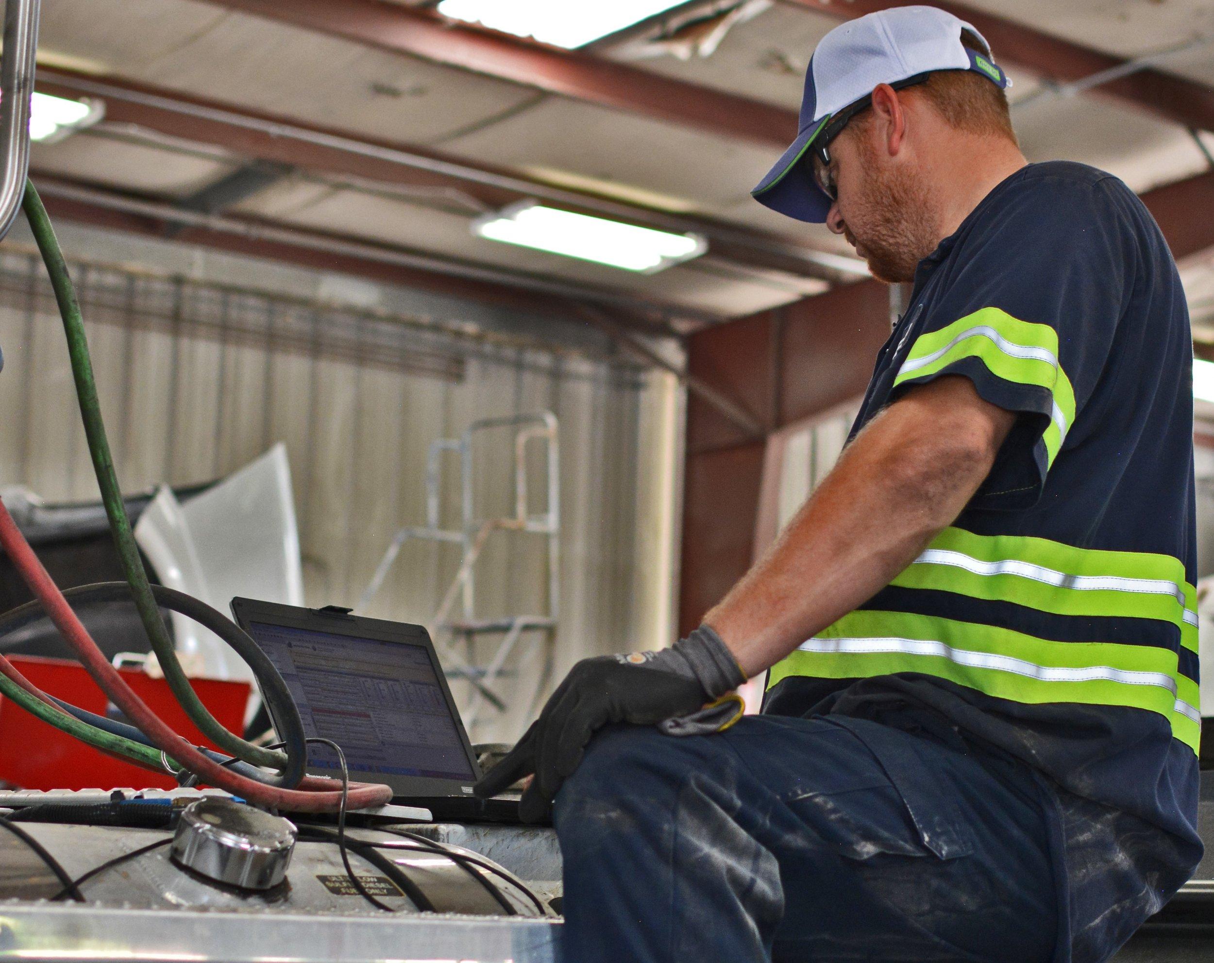 Tommy analyzes maintenance report.jpg