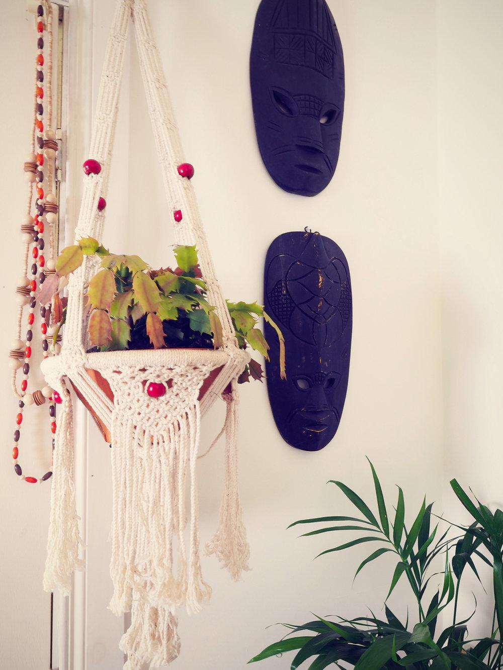 eclectic home decor - macrame hanging planter, tiki masks