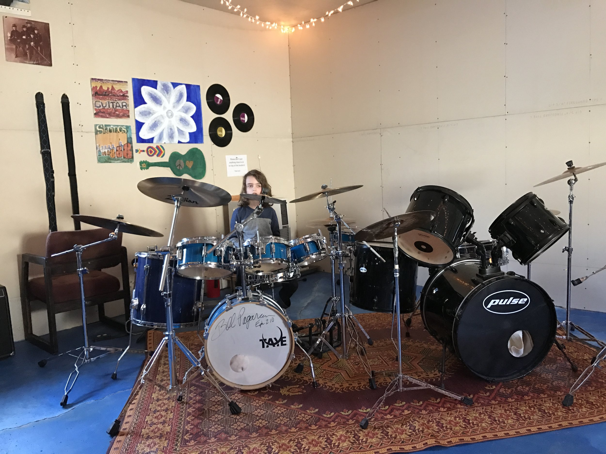 Otis tests the drums on the loud rock side of the music shack