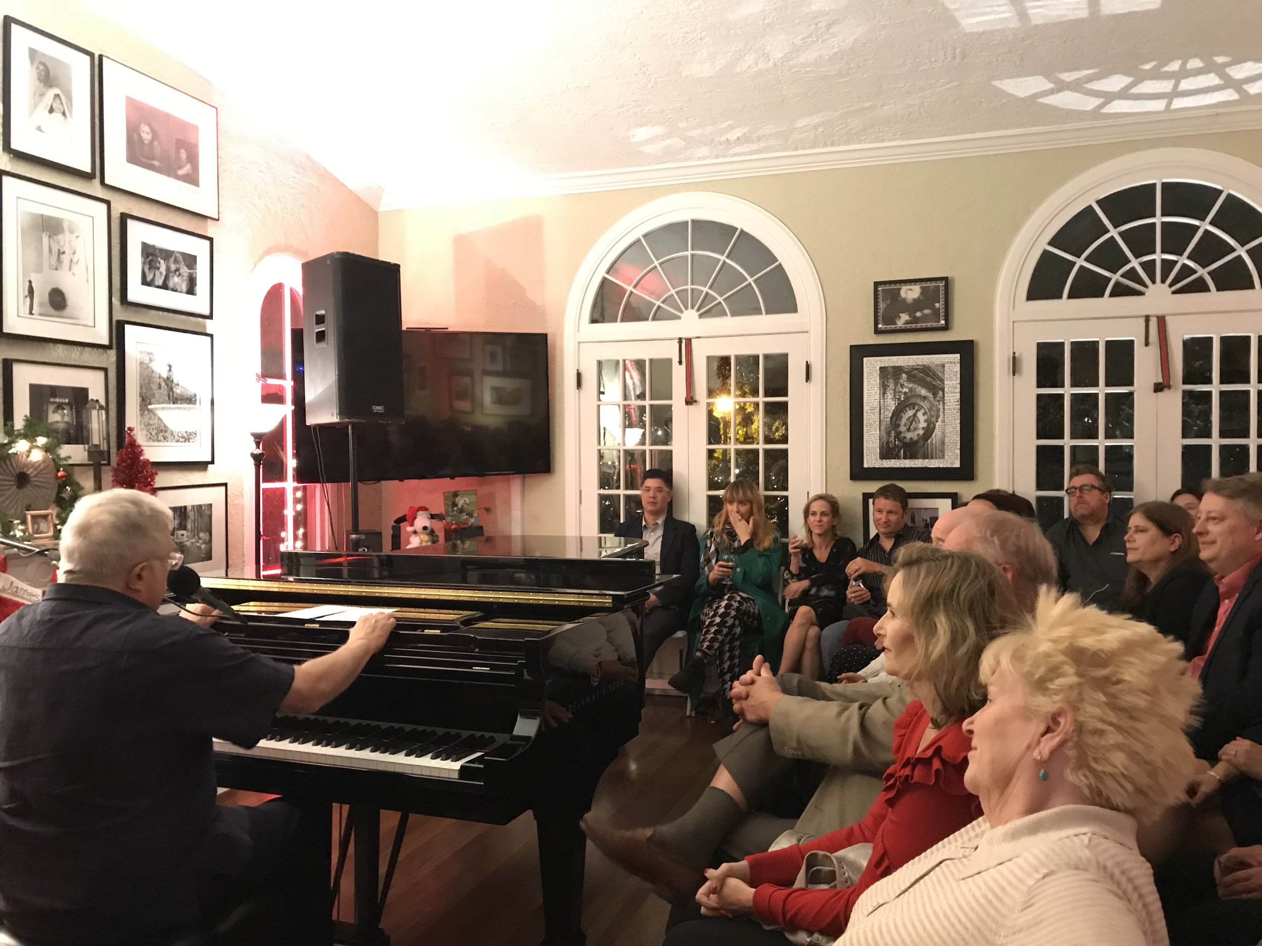 Randy Newman performing in the living room in December of 2017