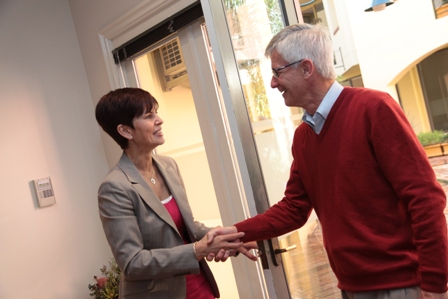Michelle Tate-Lovery greeting client.JPG