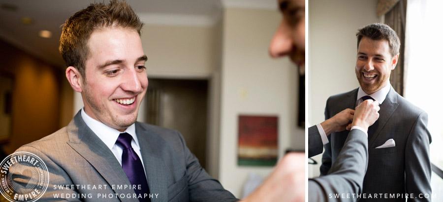 Best man helping the groom get ready.