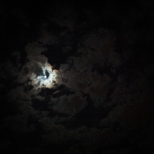 Full Moon behind clouds