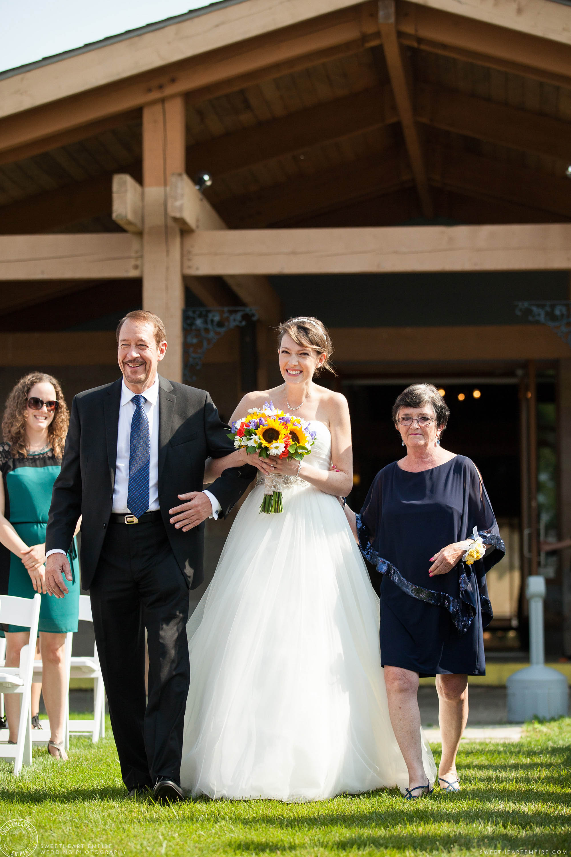 Bride bursting with excitement as she walks down the aisle at her unplugged wedding at Rockway Vineyards.