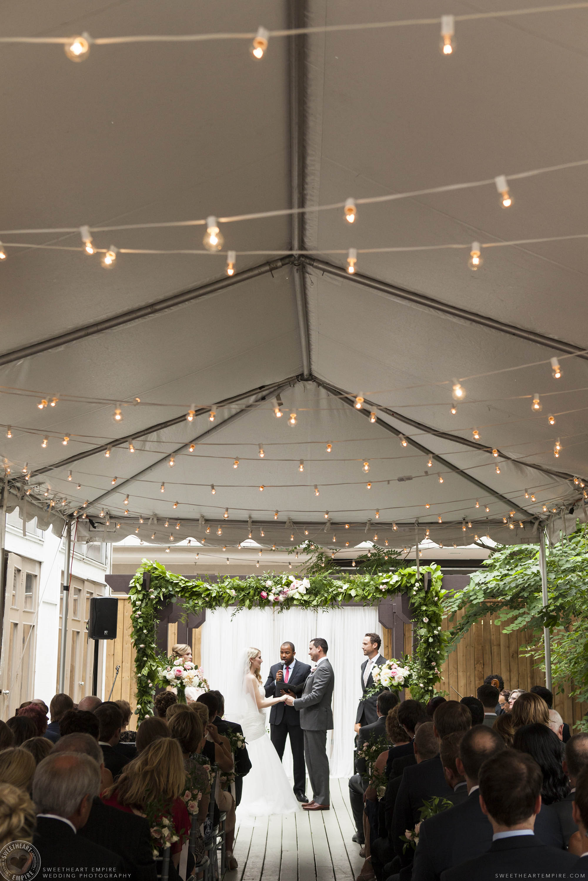 Bride and groom saying their vows at Berkeley Fieldhouse.