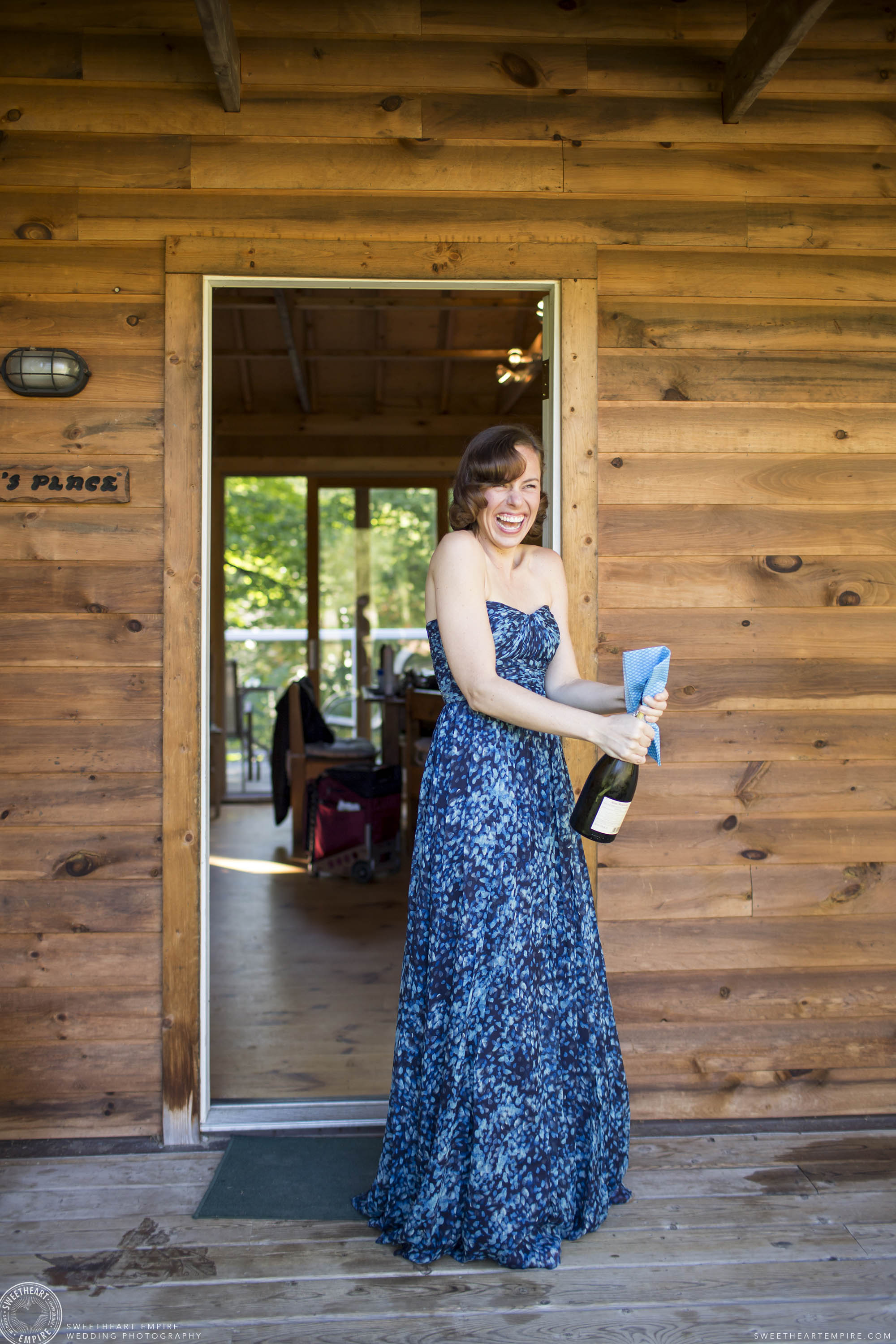 Camp Manitou Bridesmaid popping champagne