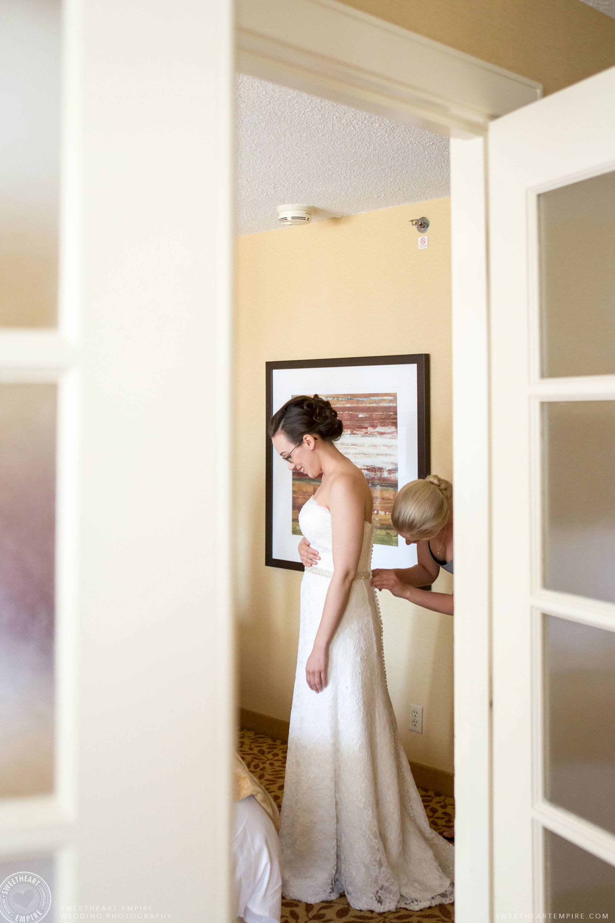 The bride getting dressed; Toronto Reference Library Wedding