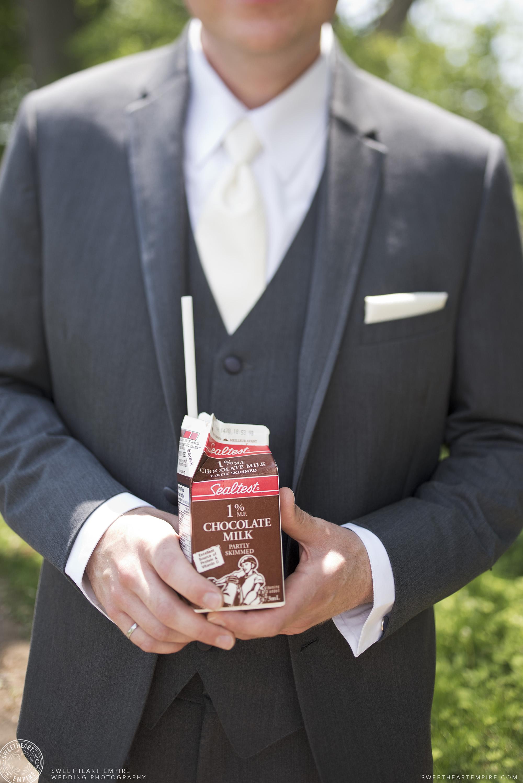 Groom holding a carton of chocolate milk, Oakville Golf Club Wedding