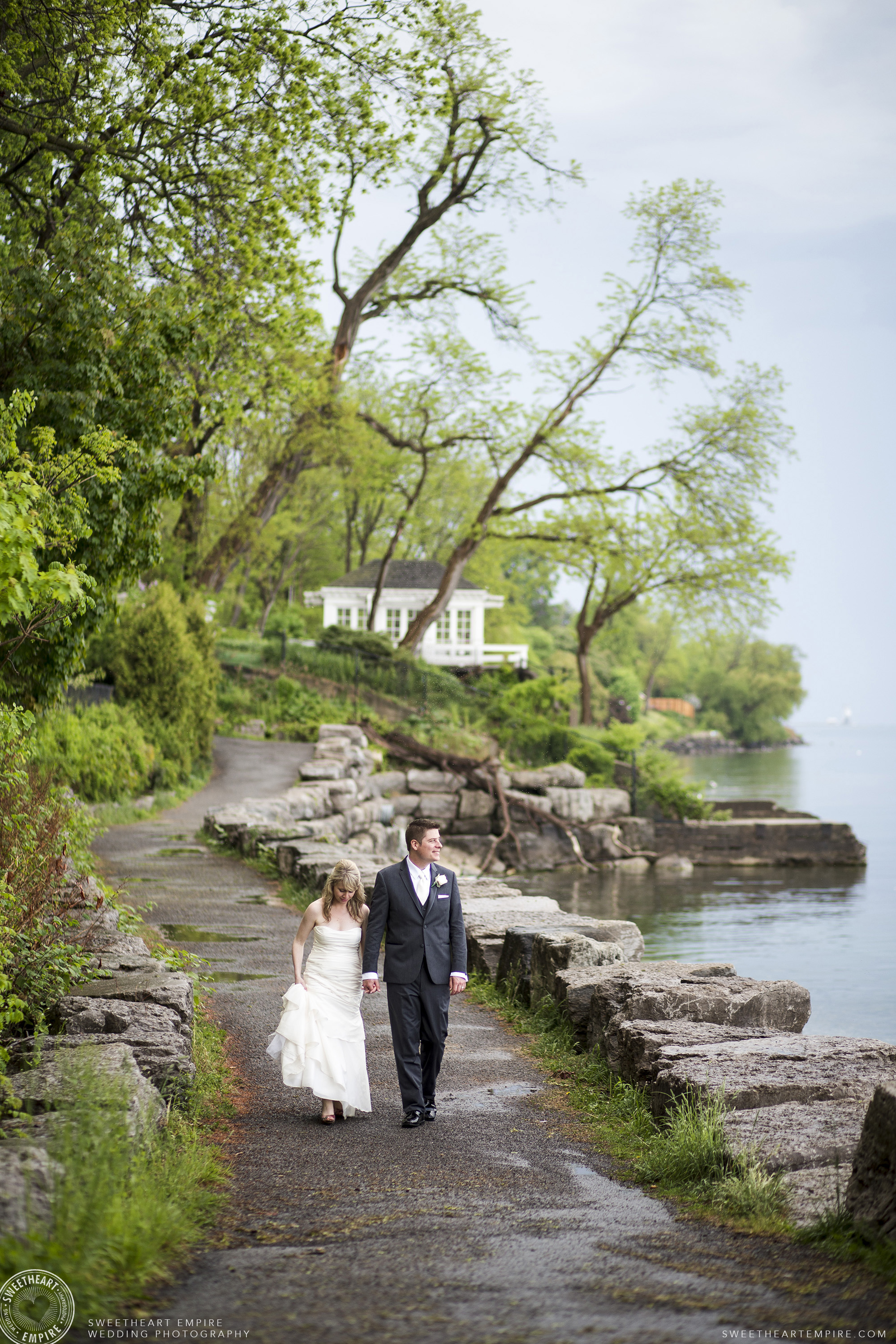 Bride and groom walk together hand in hand, Oakville Golf Club Wedding