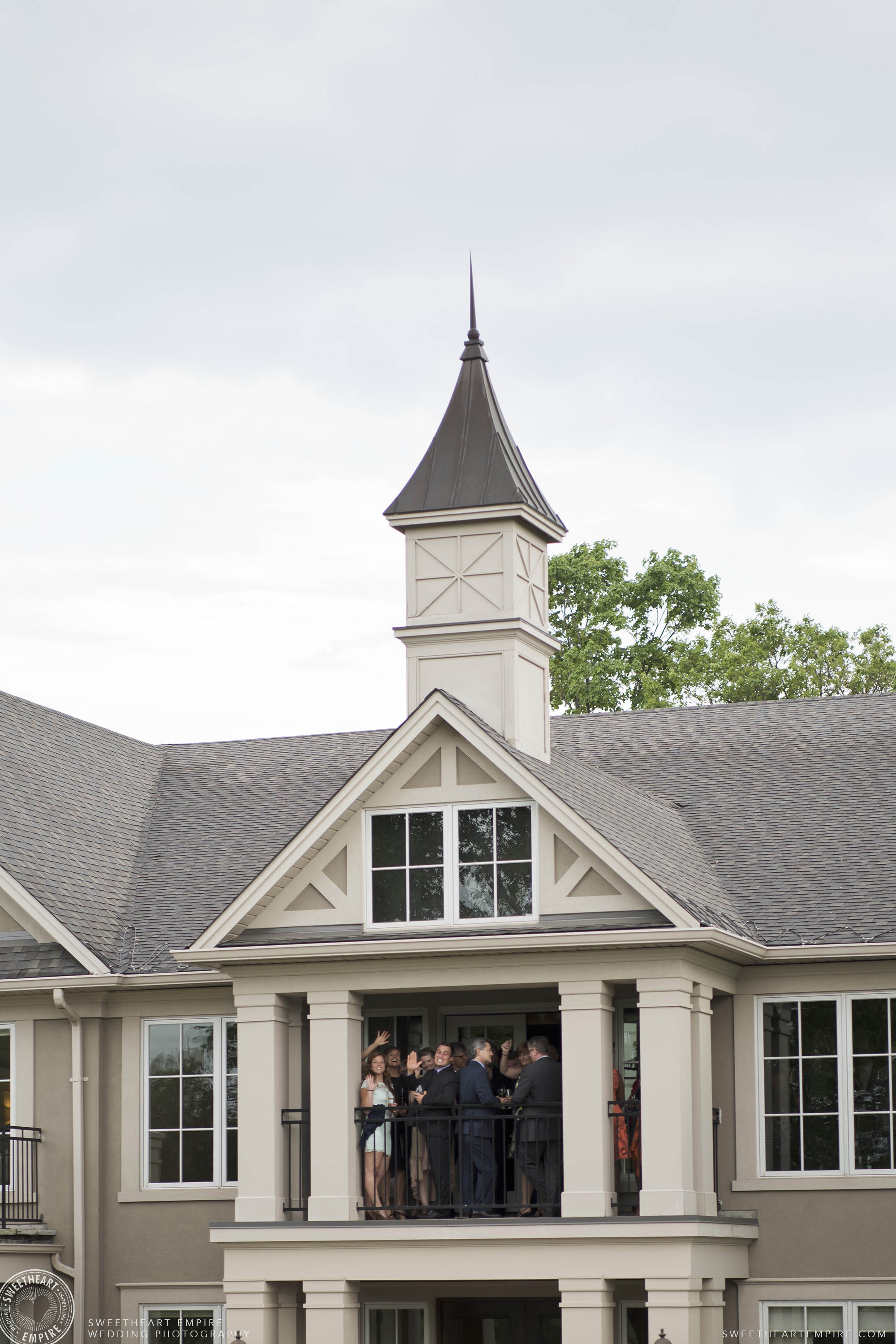 Guests on the balcony at Oakville Golf Club Wedding
