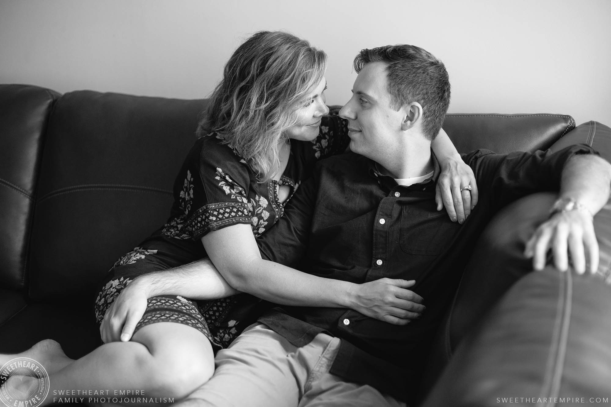 17_Wife and husband chatting and embracing on couch.jpg