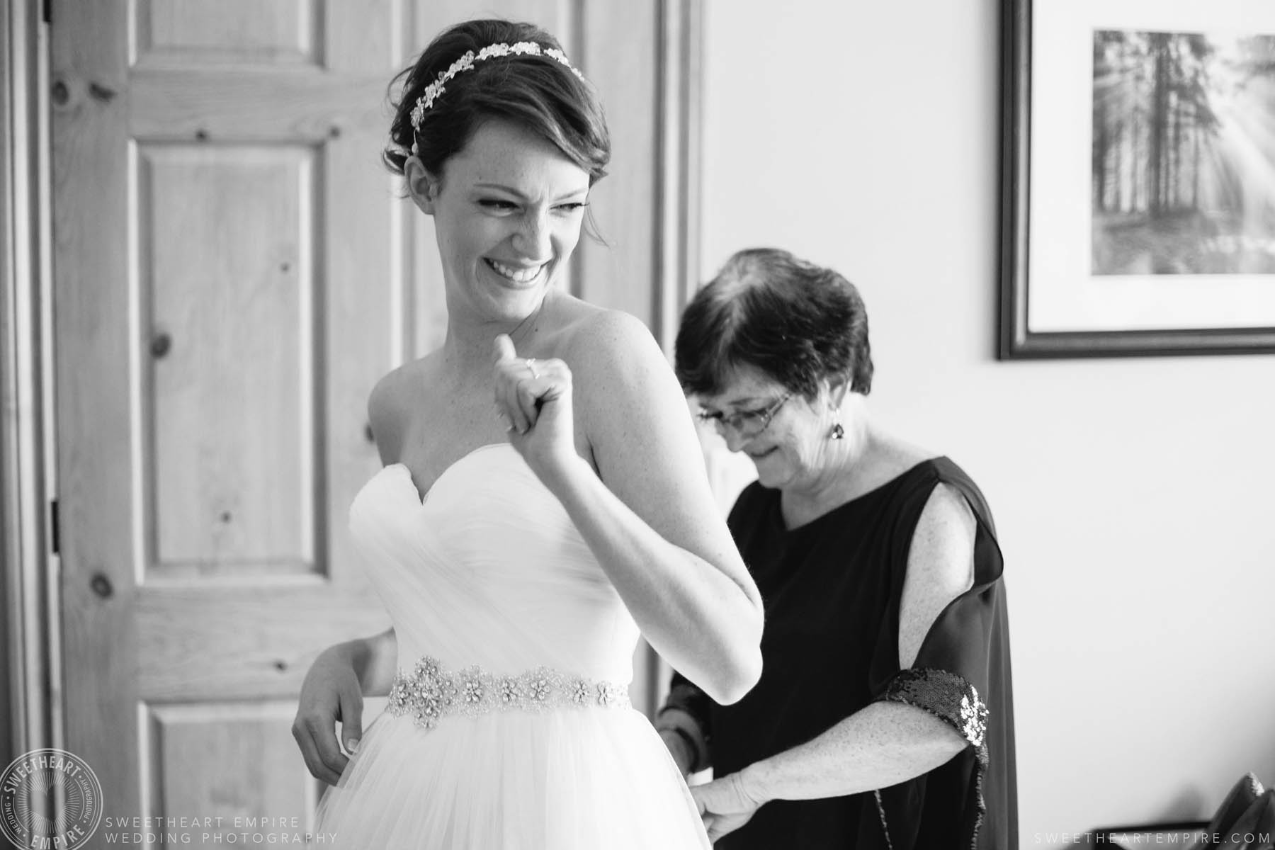 Bride gets emotional while her mom does up her wedding dress at this Rockway Vineyards wedding in Niagara.