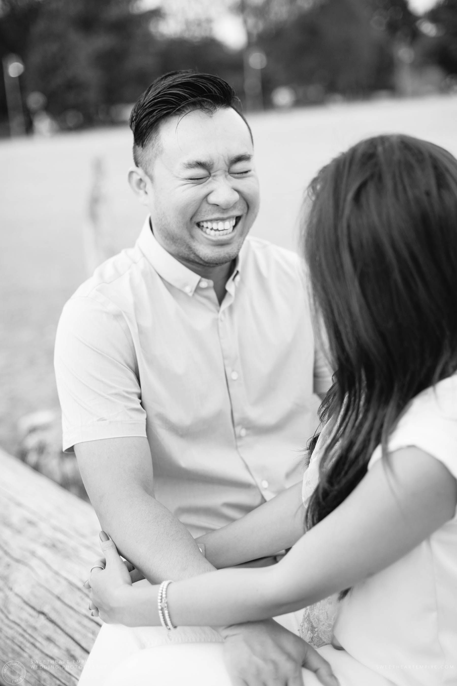 Groom to be laughing, Engagement Photos at Kew Gardens