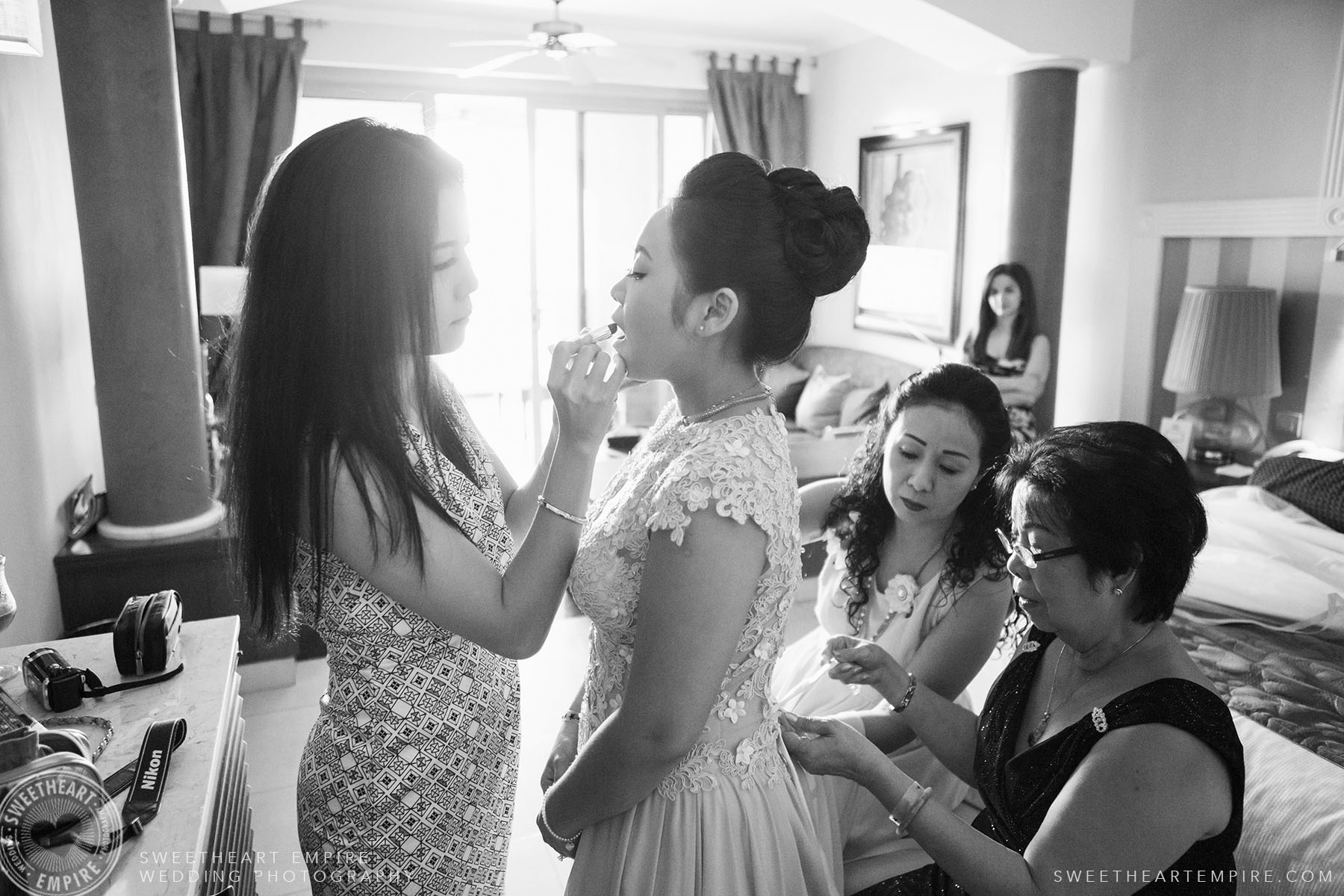 Bride getting her makeup done; Iberostar Grand Hotel Rose Hall, in Montego Bay, Jamaica