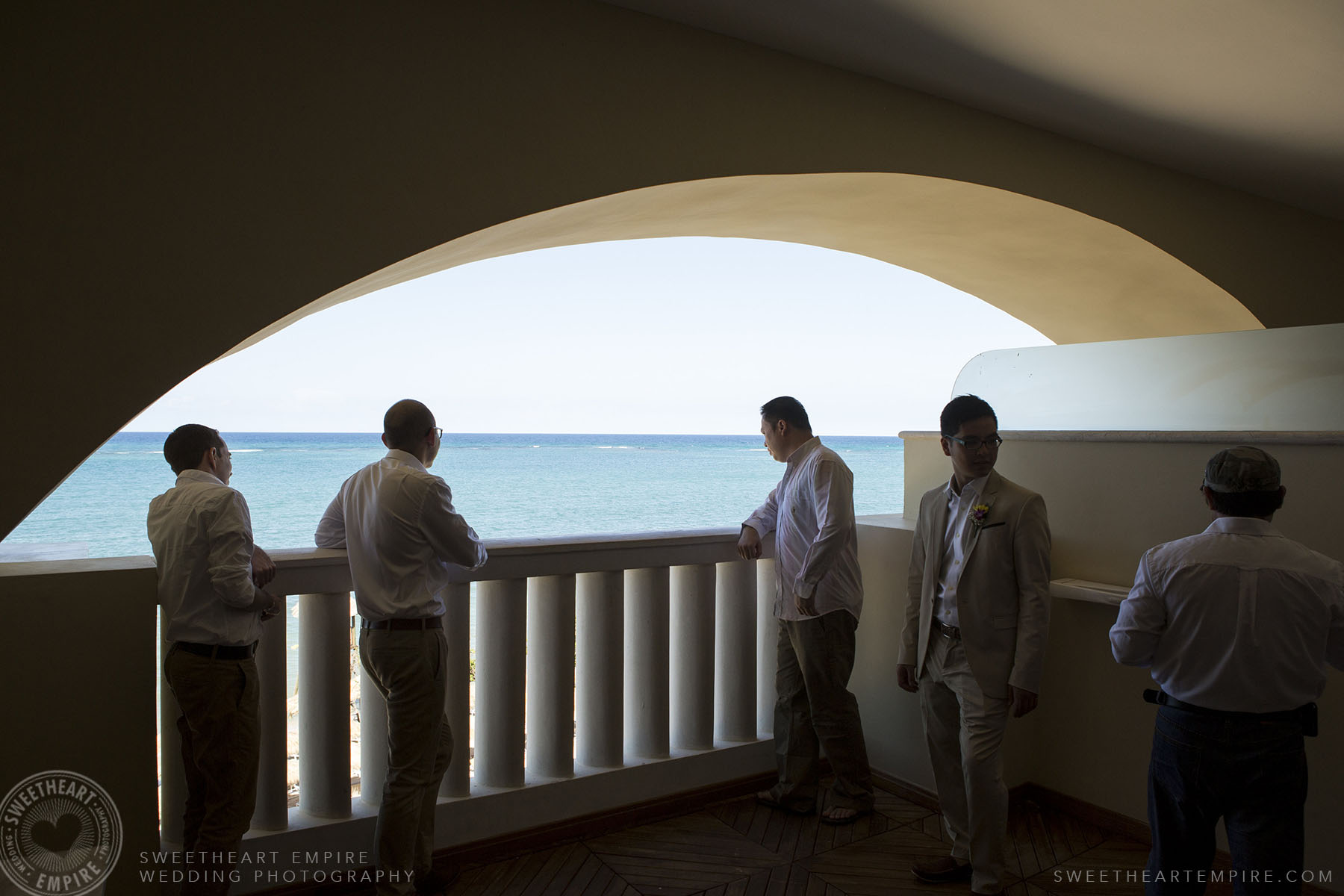 Groom and groomsmen looking at the ocean; Iberostar Grand Hotel Rose Hall, in Montego Bay, Jamaica